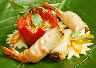 Deep fried prawns in banana leaf