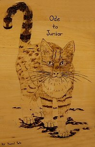 Ode to Junior pyrographed by Daniel Tate.
