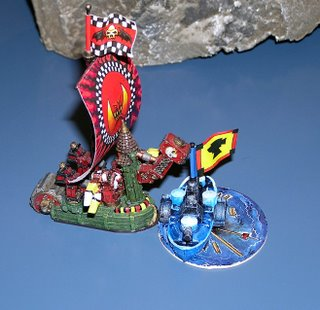 A Game of Man O War at a convention. Here an Orc Hulk attacks a Dwarf Ironclad with it's Iron Claws and Smash-hammer.