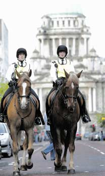 Two policewomen on horseback against the backdrop of City Hall