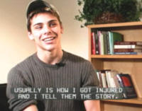 male teen talking with disability trailer on screen