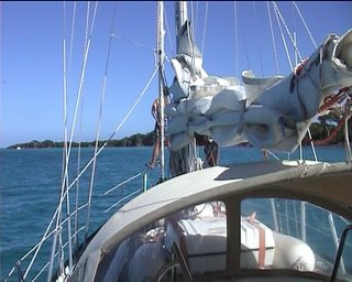 Ellen on the bow directing us through the coral