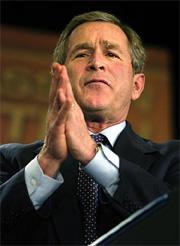 Bush en posición de oración