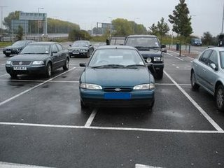 Car taking up two parking places