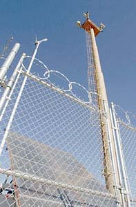 Chain-link border fence with tower