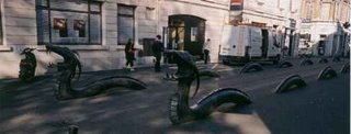 Bronze serpents separating pedestrians and traffic