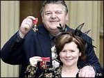 Robbie Coltrane and Imelda Staunton with their OBEs