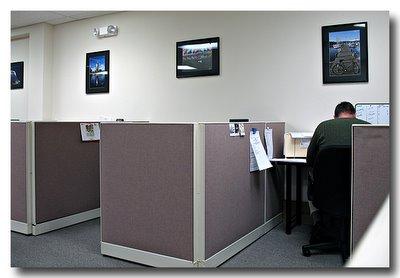 Steve Rosenbach photos decorate the mortgage company office