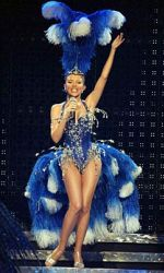Kylie in a John Galliano blue satin showgirl outfit