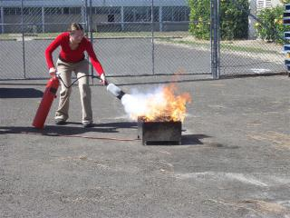 A colleague works the extinguisher