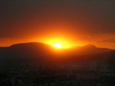 Sun hiding behing mountain.