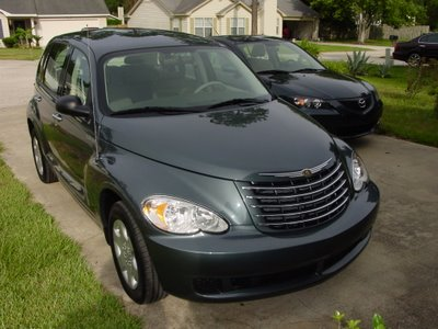 my new PT Cruiser in the driveway next to Zoom Zoom, our Mazda 3