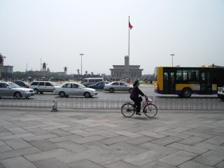 Tiananmen Square with bicyclist. Beware of tea-shop scammers.
