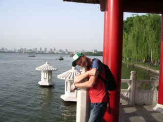 Deluded foreigner kisses stone dragon head, West Lake, Hangzhou