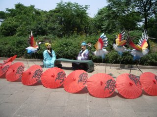 Crazy scene featuring cranes and dummies, Golden Crane Pavilion, Wuhan