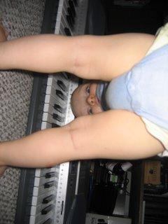 Matthew peeking through his legs back at the camera