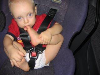 Matthew in the carseat biting his big toe