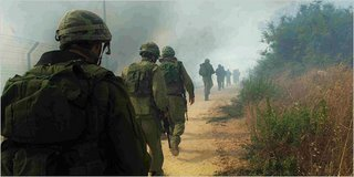 Israeli soldiers trudging Wednesday near Avivim