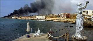 Jieh, South of Beirut, an emptied resort, a burning fuel depot after an Israeli air strike (NYT)