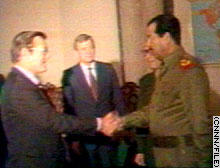 Shaking hands with Saddam