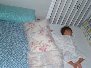 Zara sleeping in cot