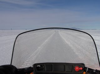 Out the windshield of the snowmobile