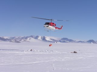 Helicopter moving the first drum