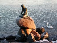 Statue of Little Mermaid, Copenhagen harbor. Full image located at http://photos1.blogger.com/blogger/1506/1865/1600/Copenhagen-Mermaid_statue.jpg; thumbnail links to page of photographs of Danish architecture