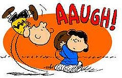 Lucy taking the football off Charlie Brown
