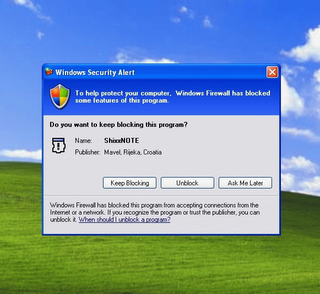 Windows Firewall dialog on Windows XP where you must click Unblock button to enable sending and receiving notes