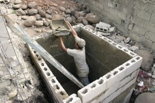 Pedro working on water tank