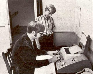 Bill Gates and Paul Allen using Model 33 Teletype