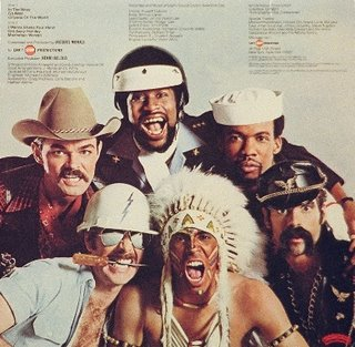 Village People (a cowboy, an Indian, a cop, a sailor, a leather clad biker and a construction worker) shown on back jacket photo of the 'Go West' LP vinyl record album