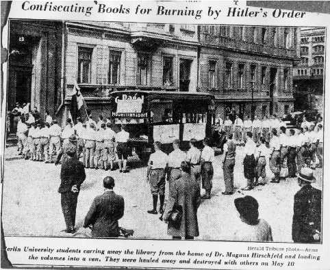 Berlin university students carrying away the library from the home of Dr. Magnus Hirschfeld on May 6, 1933 for a May 10-11 Nazi book burning. New York Herald Tribune, May 17, 1933