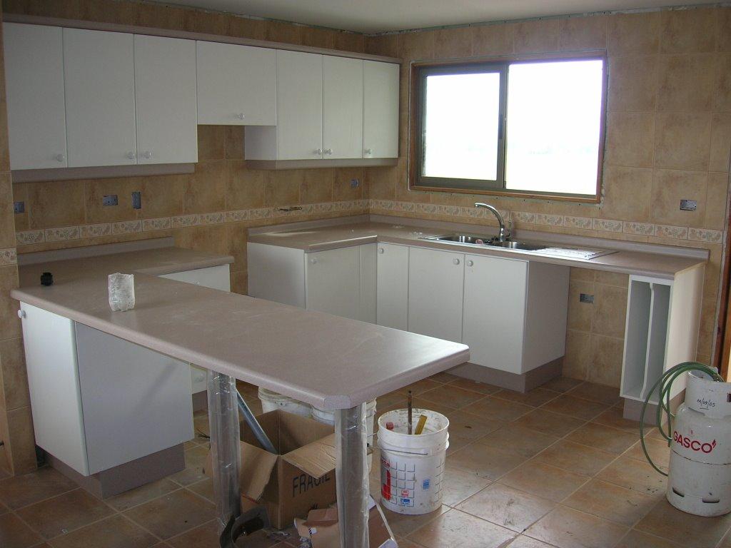 Imagenes de muebles de cocina en cemento for Cocinas de concreto forradas de azulejo