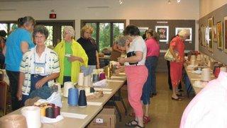 Members and guests make bids on various yarns.