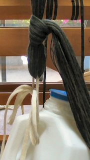 I tied the bout onto the weight with a slip knot and a shoe lace.