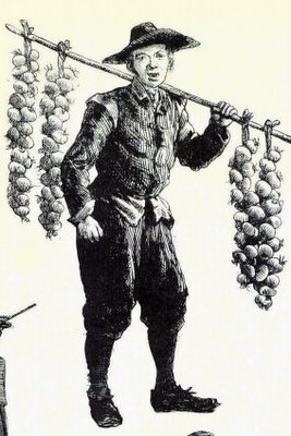 A drawing of a man carrying a pole of grapes (from the blog In Mol Araan)
