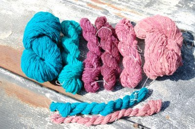 teal and pink yarns