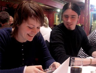 Aina and Torstein are looking at funny pictures