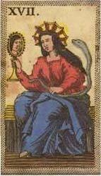 mulher com coroa olhando-se num espelho de mão e segurando uma cobra