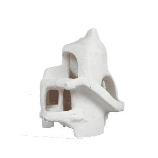 casa escultura em um bloco de argila branca