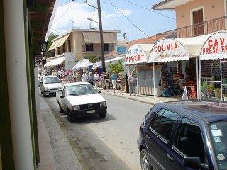 tourists coming down Gouvia main street
