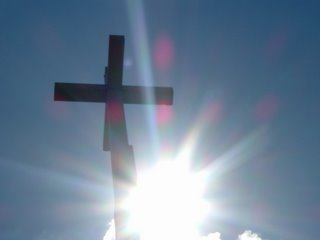Cross backlit by sun