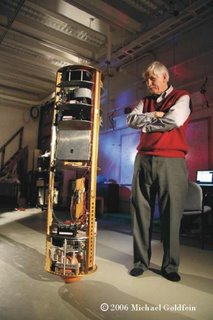 Ballbot balancing in the CMU motion capture lab, with Ralph Hollis looking on.