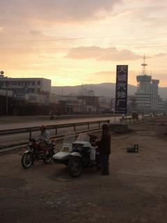 Sunset bikers on the road to Kunming