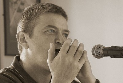 Paul playing harmonica