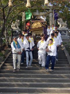 mikoshi being carried down the steps