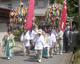 Suijin matsuri - the portable shrines are carried down to the river to the accompaniment of traditional music