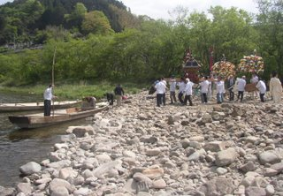 Suijin matsuri - the mikoshi are placed on boats